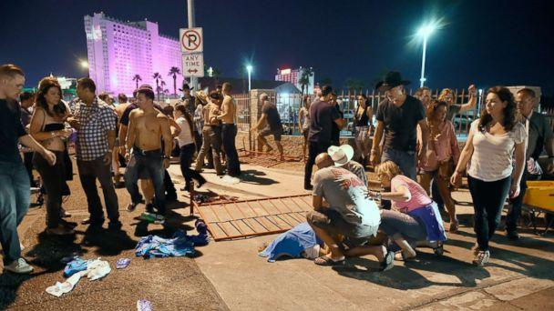 PHOTO: People tend to the wounded outside the festival grounds, Oct. 1, 2017, in Las Vegas. (David Becker/Getty Images)