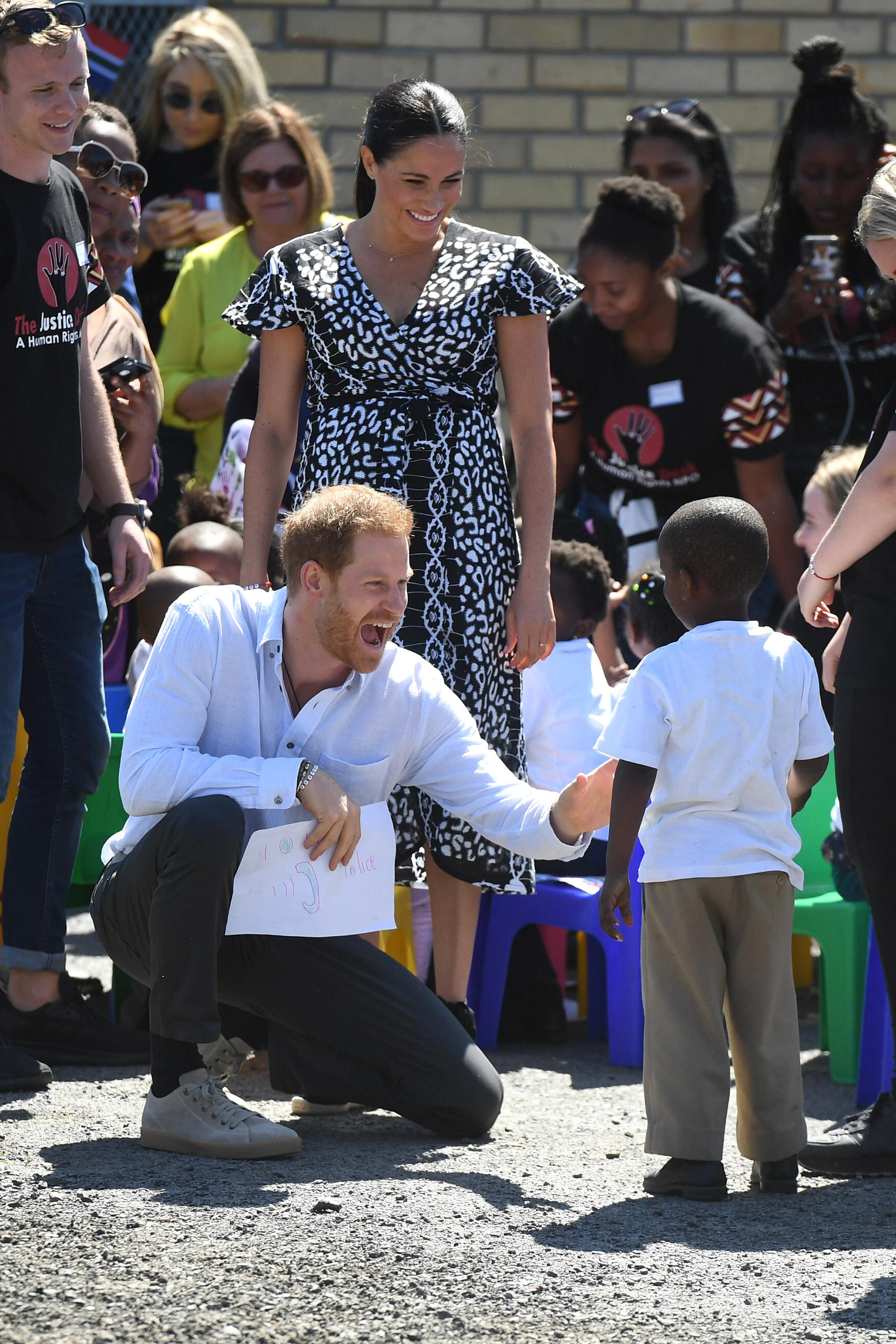 CAPE TOWN, SOUTH AFRICA - SEPTEMBER 23: Prince Harry, Duke of Sussex and Meghan, Duchess of Sussex visit a workshop that teaches children about their rights, self-awareness and safety during their royal tour of South Africa on September 23, 2019 in Cape Town, South Africa. (Photo by Samir Hussein/WireImage)