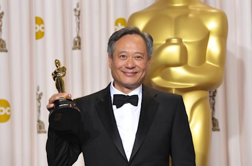 "Ang Lee poses with his award for best directing for ""Life of Pi"" during the Oscars at the Dolby Theatre on Sunday Feb. 24, 2013, in Los Angeles. (Photo by John Shearer/Invision/AP)"