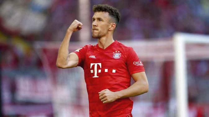 Gelandang Bayern Munchen, Ivan Perisic, melakukan selebrasi usai membobol gawang Koln pada laga Bundesliga di Allianz Arena, Sabtu (21/9/2019). Bayern Munchen menang 4-0 atas Koln. (AP/Matthias Schrader)