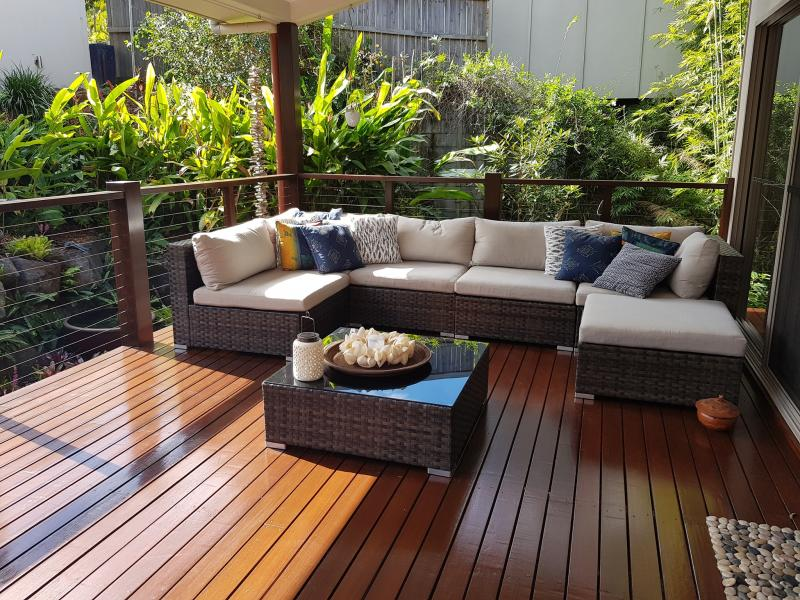 A sunny lounge on the back patio of a Sunshine Coast home is seen. A snake is hiding somewhere in the picture.