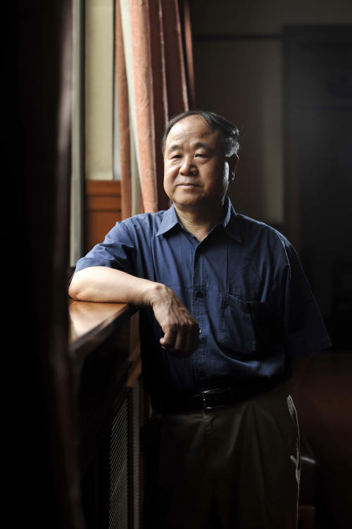 In this photo taken Tuesday Aug. 2, 2011, Chinese writer Mo Yan poses for photos in a theater in Beijing. Mo was awarded the Nobel Prize in literature on Thursday, Oct 11, 2012, a cause of pride for a government that had disowned the only previous Chinese winner of the award, an exiled critic. (AP Photo) CHINA OUT
