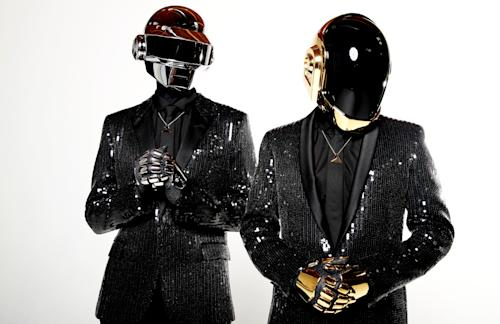"In this April 17, 2013 photo, Thomas Bangalter, left, and Guy-Manuel de Homem-Christo, from the music group, Daft Punk, pose for a portrait in Los Angeles. The electronic duo's new studio album, ""Random Access Memories"" releases in the US on May 21, 2013. (Photo by Matt Sayles/Invision/AP)"