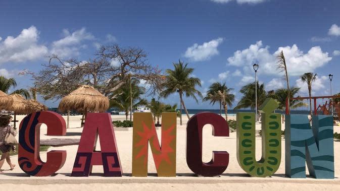 Ilustrasi Pantai Cancun, Meksiko (DANIEL SLIM / AFP)