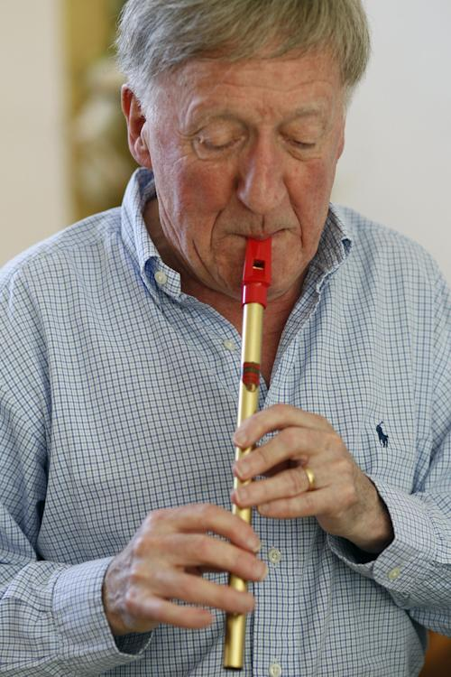 "In this April 2, 2012 photo, Irish musician Paddy Moloney of the Chieftains, plays a tin whistle at his home in Naples, Fla. Moloney collaborates with musicians, Bon Iver, the Pistol Annies, the Civil Wars, the Secret Sisters, the Carolina Chocolate Drops on The Chieftains' 50th anniversary album, ""Voice of Ages."" (AP Photo/Lynne Sladky)"