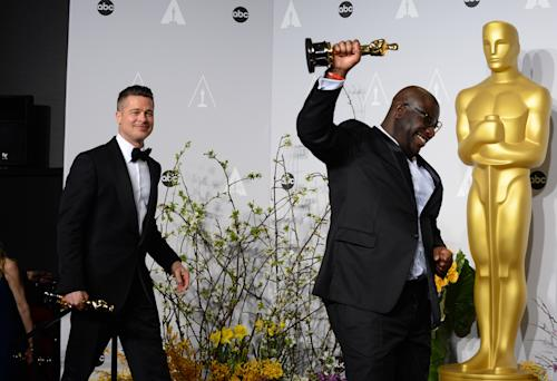 "Brad Pitt, left, and Steve McQueen pose in the press room with the award for best picture for ""12 Years a Slave"" during the Oscars at the Dolby Theatre on Sunday, March 2, 2014, in Los Angeles. (Photo by Jordan Strauss/Invision/AP)"