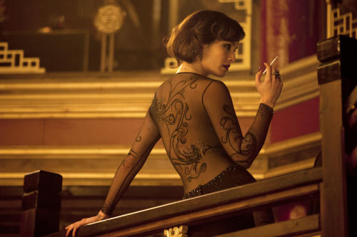 "FILE - This film image released by Sony Pictures shows Berenice Marlohe wearing a gown by designer L'Wren Scott in a scene from the film ""Skyfall."" Scott was found dead Monday, March 17, 2014, in Manhattan of a possible suicide. (AP Photo/Sony Pictures, Francois Duhamel, File)"