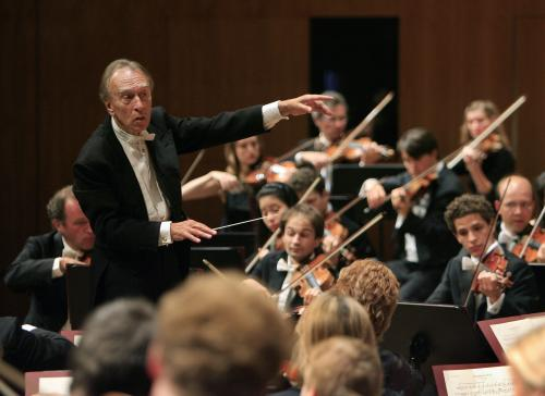 FILE - In this Aug. 10, 2007 filer, conductor Claudio Abbado, left, conducts his orchestra during the opening concert of the Lucerne Festival in Lucerne, Switzerland. Claudio Abbado, a star in the great generation of Italian conductors who was revered by musicians in the world's leading orchestras for developing a strong rapport with them while still allowing them their independence, has died Monday, Jan. 20, 2104. He was 80. Abbado made his debut in 1960 at La Scala in his home city of Milan and went on to be its musical director for nearly 20 years. Among his many other stints were as musical director of the Vienna State Opera, the Berlin Philharmonic and the London Symphony Orchestra and chief guest conductor of the Chicago Philharmonic. Even as he battled illness in his later years, Abbado founded his own all-star orchestra in Lucerne, Switzerland. (AP Photo/Eddy Risch, Keystone)