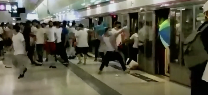 It is believed the masked men in white t-shirts targeted anti-government protesters. Source: Reuters