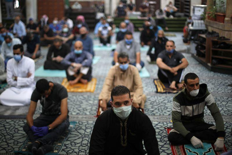Muslims attend Friday prayers at al Husseini mosque in Amman