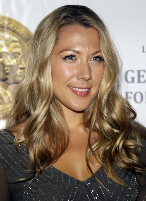 Colbie Caillat poses for photographers before an event to honor singer-songwriter Carol King with the Gershwin Prize for Popular Song, at the Library of Congress, Tuesday, May 21, 2013 in Washington. (AP Photo/Alex Brandon)
