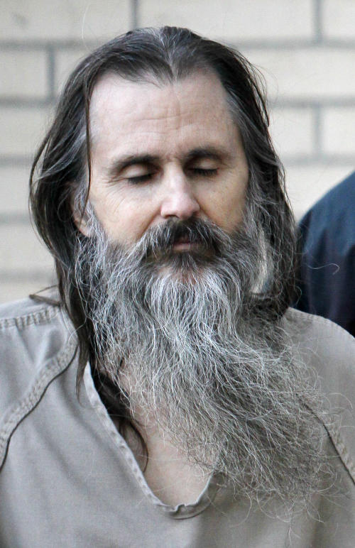 "FILE - In this Dec. 10, 2010, file photo, Brian David Mitchell is escorted by a U.S. Marshall as he arrives at the federal court house, in Salt Lake City. More than a decade after her kidnapping and rescue grabbed national headlines, Elizabeth Smart is publishing a memoir of her ordeal. The 308 page book, titled ""My Story,"" is being released by St. Martin's Press on Monday, Oct. 7, 2013. (AP Photo/Colin E Braley, File)"