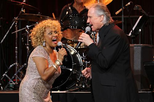"""Singers Darlene Love and Bill Medley perform at the """"Right To Rock Benefit"""" at Cipriani Wall Street, on Thursday, Oct. 17, 2013 in New York. (Photo by Greg Allen/Invision/AP)"""