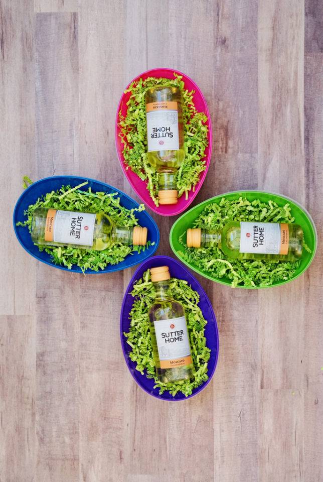 """<p>Single serving wine bottles make for the perfect treasure hidden inside your 21+ Easter eggs.</p><p><strong>Get the tutorial at <a href=""""https://www.thetrophywifestyle.com/the-blog-life/boozy-easter-eggs"""" target=""""_blank"""">The Trophy Wifestyle</a>.</strong></p><p><strong><a class=""""body-btn-link"""" href=""""https://www.amazon.com/JOYIN-Assorted-Stuffers-Classroom-Supplies/dp/B079PKLYRD/?tag=syn-yahoo-20&ascsubtag=%5Bartid%7C10050.g.16593389%5Bsrc%7Cyahoo-us"""" target=""""_blank"""">SHOP JUMBO EASTER EGGS</a><br></strong></p>"""