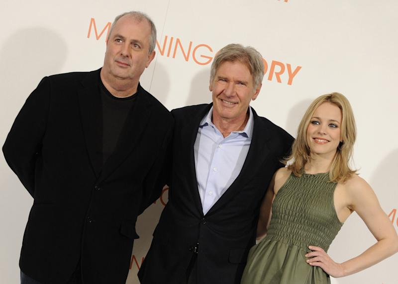 """Director Roger Michell (L), actor Harrison Ford (C) and actress Rachel McAdams (R) attend the """"Morning Glory"""" photocall at the Villamagna Hotel on January 13, 2011 in Madrid, Spain. (Photo by Fotonoticias/WireImage)"""