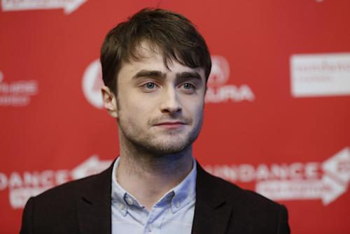 """File - Actor Daniel Radcliffe poses at the premiere of """"Kill Your Darlings"""" during the 2013 Sundance Film Festival on Friday, Jan. 18, 2013 in Park City, Utah. Radcliffe has really left Harry Potter behind with a startling and explicit Sundance Film Festival role as poet Allen Ginsberg that puts Radcliffe into daring territory. (Photo by Danny Moloshok/Invision/AP, file)"""