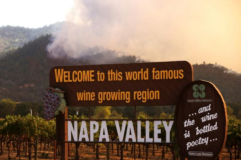 Tens of thousands flee wildfires roaring through California wine regions