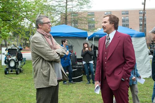 """This image released by Paramount Pictures shows Adam McKay, left, and Will Ferrell on the set of """"Anchorman 2: The Legend Continues."""" Ferrell returns to portray newscaster Ron Burgundy in the sequel to """"Anchorman: The Legend of Ron Burgundy."""" (AP Photo/Paramount Pictures, Gemma LaMana)"""