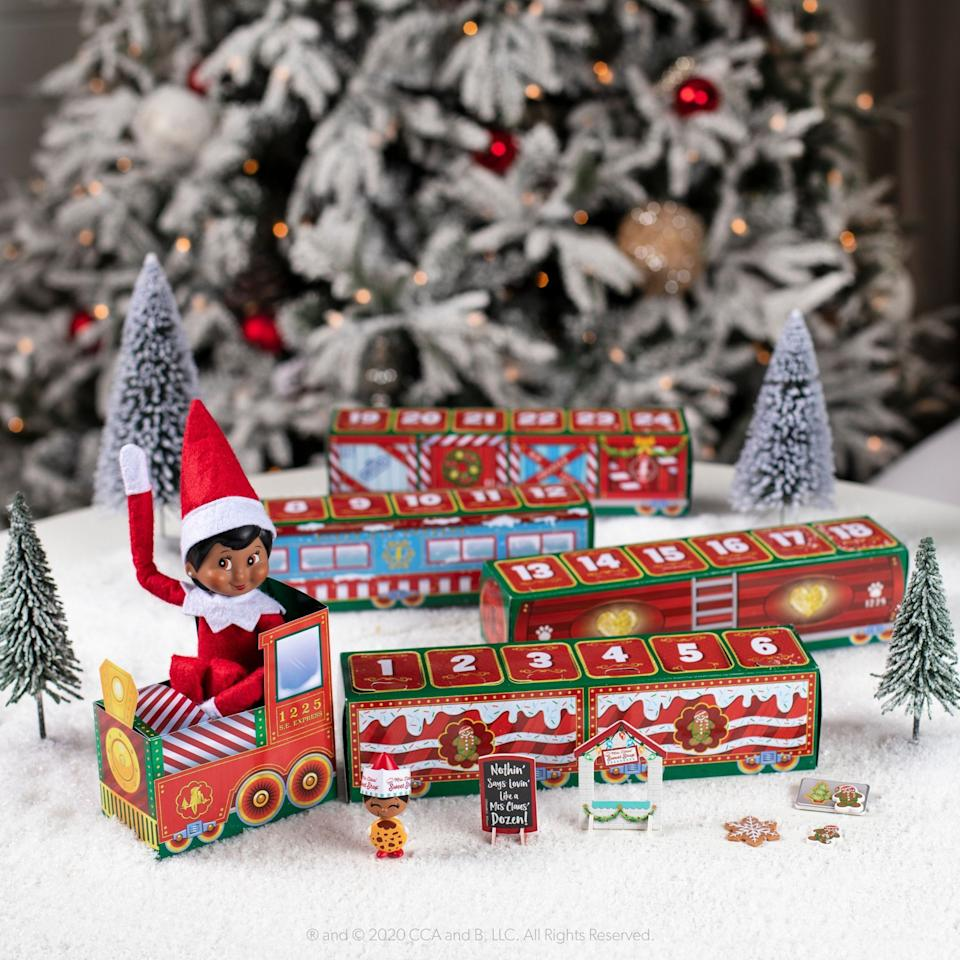 """<p><strong>Elf on the Shelf</strong></p><p>target.com</p><p><strong>$24.95</strong></p><p><a href=""""https://www.target.com/p/north-pole-advent-train/-/A-79924381"""" target=""""_blank"""">Shop Now</a></p><p>New this year, the North Pole Advent Train includes four themed trains (think """"Sweet Shop"""" and """"Puppy Love"""") with new accessories and mini figures behind each door. </p>"""