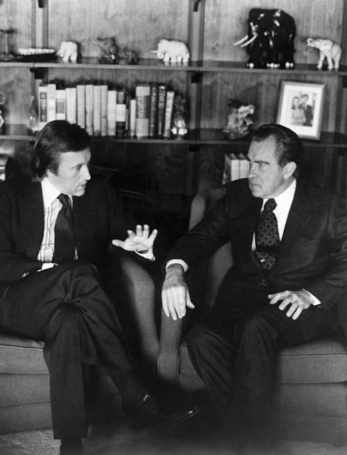 File - David Frost, left, talks with former President Richard Nixon in this March 1977 b/w file photo prior to the taping of his interview with the former President. Veteran broadcaster David Frost, who won fame around the world for his interview with former President Richard Nixon, has died, his family told the BBC. He was 74. Frost died of a heart attack on Saturday night aboard the Queen Elizabeth cruise ship, where he was due to give a speech, the family said. The cruise company Cunard says its vessel had left the English port of Southampton on Saturday for a 10-day cruise in the Mediterranean. (AP Photo, File) EDITORIAL USE ONLY