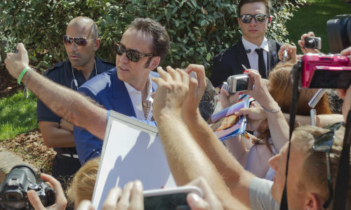 Actor Nicolas Cage arrives for a press conference at the 70th edition of the Venice Film Festival held from Aug. 28 through Sept. 7, in Venice, Italy, Friday, Aug. 30, 2013. (AP Photo/Domenico Stinellis)