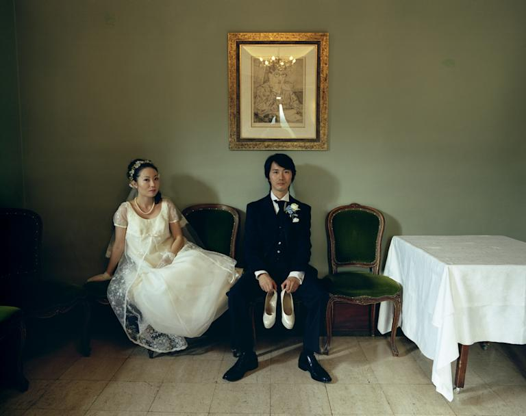 'People' catgegory: Hisatomi Tadahiko, Japan. A groom holds his bride's shoes in 'Wedding'. (Sony World Photography Awards)