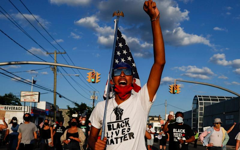 A Black Lives Matter protester in New York state on Tuesday - AP