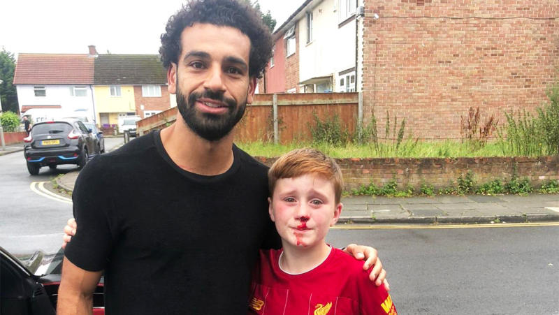 Mo Salah took a photo with the young Louis Fowler after the Liverpool fan hurt himself chasing the Reds forward. (Image: Twitter)