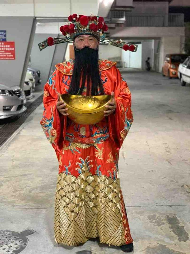 It takes Steven Chan less than 30 minutes to dress up as the God of Prosperity. — Picture courtesy of Steven Chan