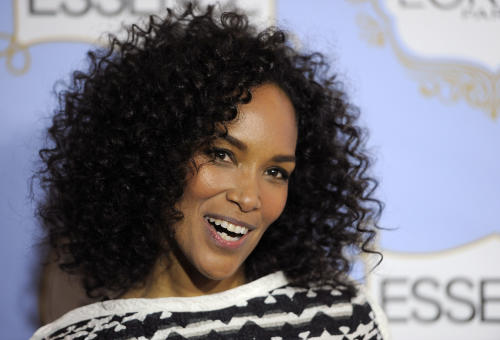 Producer Mara Brock Akil, recipient of the Visionary Award, poses at the 6th Annual Black Women in Hollywood Luncheon at the Beverly Hills Hotel on Thursday, Feb. 21, 2013 in Los Angeles. (Photo by Chris Pizzello/Invision/AP)