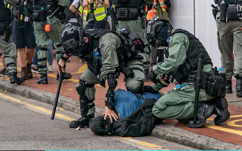 Riot police arrest a protestor in Hong Kong - Anthony Kwan/Getty Images