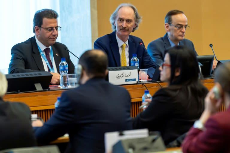 UN Syria envoy Geir Pedersen flanked by  metting co-chairs Ahmad Kuzbari (l) and Hadi Albahra in Geneva