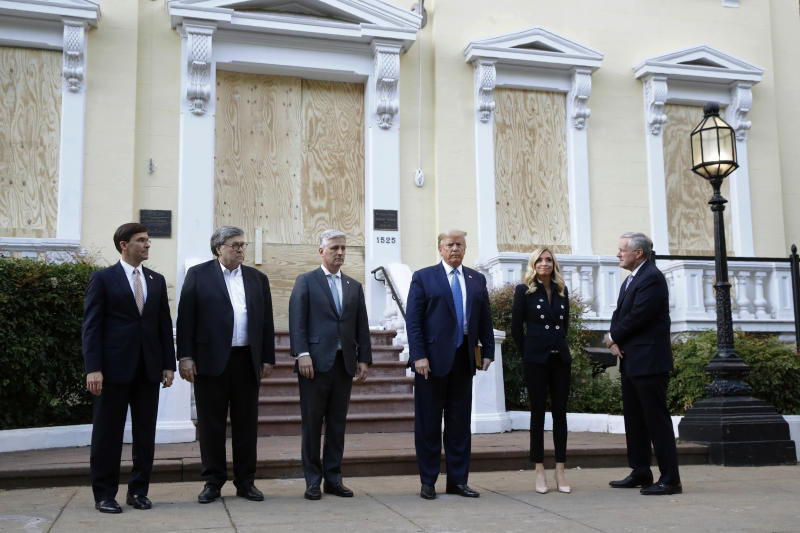 FILE - In this June 1, 2020, file photo President Donald Trump stands outside St. John's Church across Lafayette Park from the White House in Washington. Standing with Trump are Defense Secretary Mark Esper, from left, Attorney General William Barr, White House national security adviser Robert O'Brien, White House press secretary Kayleigh McEnany and White House chief of staff Mark Meadows. (AP Photo/Patrick Semansky, File)