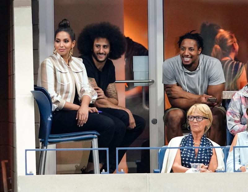 Colin Kaepernick, center, thanked his friend and former teammate, Carolina Panthers safety Eric Reid, right, for his support. (Getty Images)