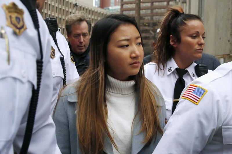 """Inyoung You leaves Suffolk Superior Court in Boston, Friday, Nov. 22, 2019 after pleading not guilty to involuntary manslaughter. Prosecutors say You sent Alexander Urtula more than 47,000 text messages in the last two months of their relationship, including many urging him to """"go kill yourself."""" (AP Photo/Michael Dwyer)"""