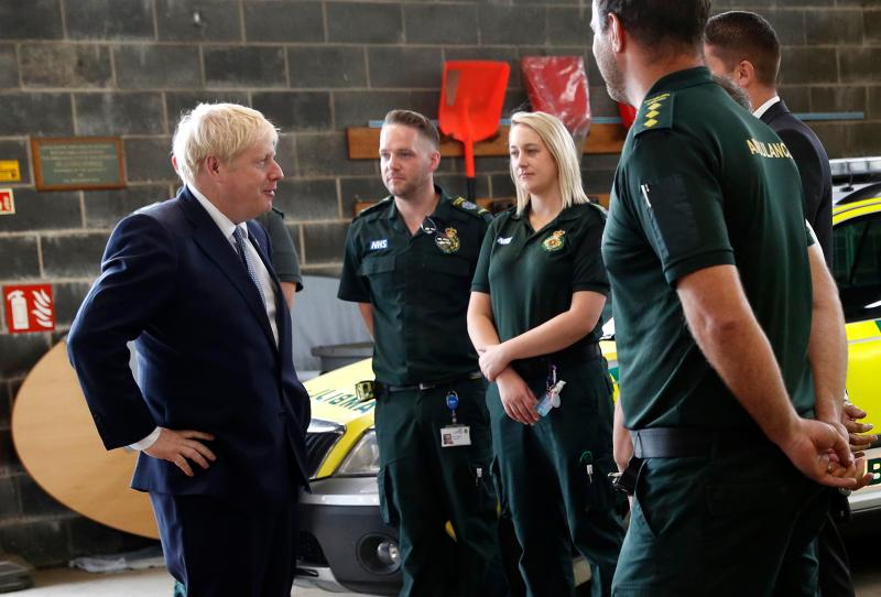 Boris Johnson chats with Ambulance crews during a visit to Pilgrim Hospital in Boston, eastern England, on Monday. (Getty)