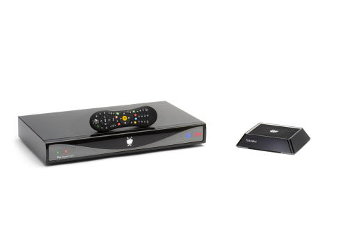 This image provided by TiVo, Inc., shows the new Roamio Plus and remote, left, with the TiVo mini, right, which extends the functionality of the main TiVo into another room. TiVo, Inc. announced a new line of digital video recorders Tuesday, Aug. 20, 2013, to give television viewers more control over what they watch on traditional channels and over the Internet. (AP Photo/TiVo, Inc).
