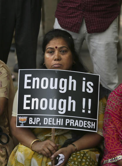 An Indian woman holds a placard during a protest to demand for tougher rape laws and better police protection for women, outside the Parliament in New Delhi, India, Monday, April 22, 2013. A second suspect was arrested Monday in the rape of a 5-year-old girl who New Delhi police say was left for dead in a locked room, a case that has brought a new wave of protests against how Indian authorities handle sex crimes. (AP Photo/Manish Swarup)