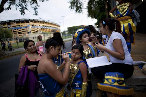 "Members of the murga ""Los amantes de La Boca"" prepare to participate in carnival celebrations in Buenos Aires, Argentina, Saturday, Feb. 2, 2013. Argentina's carnival celebrations may not be as well-known as the ones in neighboring Uruguay and Brazil, but residents of the nation's capital are equally passionate about their ""murgas,"" or traditional musical troupes. The murga ""Los amantes de La Boca,"" or ""The Lovers of The Boca"" is among the largest, with about 400 members. It's a reference to the hometown Boca Juniors, among the most popular soccer teams in Argentina and the world. (AP Photo/Natacha Pisarenko)"