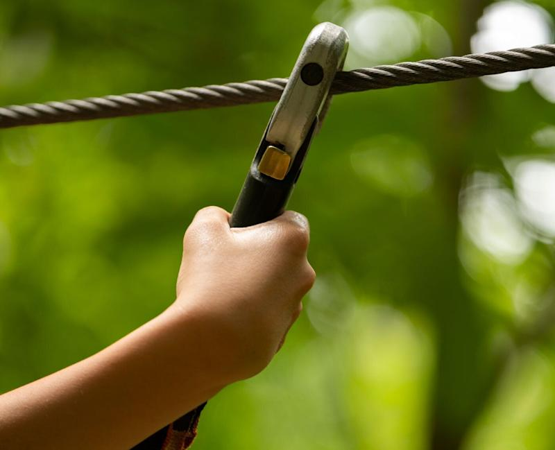 There are fears a woman might be paralysed after crashing during a ride on a flying fox or zip-line in Belrose on Sydney's Northern Beaches. The picture shows a stock image of a wire with a clamp.