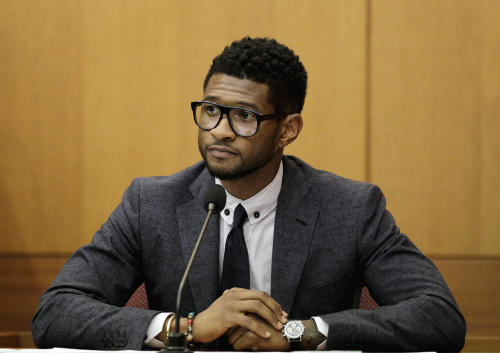 FILE - Hip-hop artist Usher Raymond takes the witness stand in court in a legal battle with his ex-wife in a custody fight involving their two sons in this May 22, 2012 file photo taken in Atlanta. Willie A. Watkins funeral home in Atlanta confirmed Saturday July 21, 2012 it is handling funeral arrangements for 11-year-old Kirk Glover. He was the son of Usher's ex-wife Tameka Foster. The boy was run over July 6 by a personal watercraft on Lake Lanier, according to the Georgia Department of Natural Resources. (AP Photo/David Goldman, File)