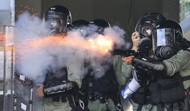 Riot police fire tear gas during an anti-government rally in Wong Tai Sing on National Day in October 2019. Photo: James Wendlinger
