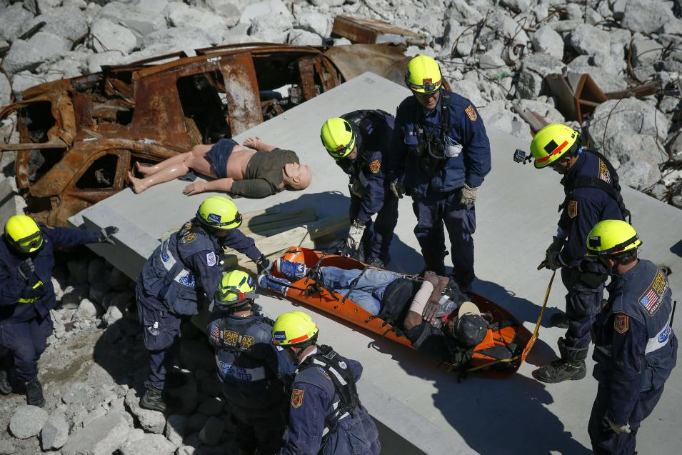Rescue specialists for USA-1 rescue a victim from the scene of a mock disaster area during a training exercise at the Guardian Center in Perry