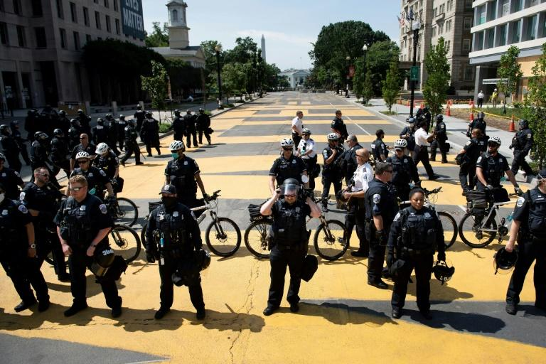 DC Police hold a line after pushing a small group protestors out of Black Lives Matter Plaza near the White House