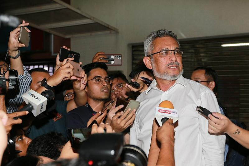 Amanah's Khalid Samad speaks to reporters after the Pakatan Harapan Presidential Council Meeting at the PKR headquarters in Kuala Lumpur February 25, 2020. — Picture by Ahmad Zamzahuri