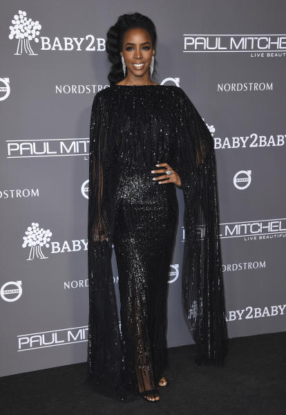 """FILE - This Nov. 10, 2018 file photo, Kelly Rowland attends the 2018 Baby2Baby Gala in Culver City, Calif. Rowland says her new single """"Coffee"""" and its accompanying music video is her """"ode to the beauty of black women."""" She debuted the breezy R&B track and video featuring black women across a spectrum of shades and colors two weeks ago. (Photo by Jordan Strauss/Invision/AP, File)"""