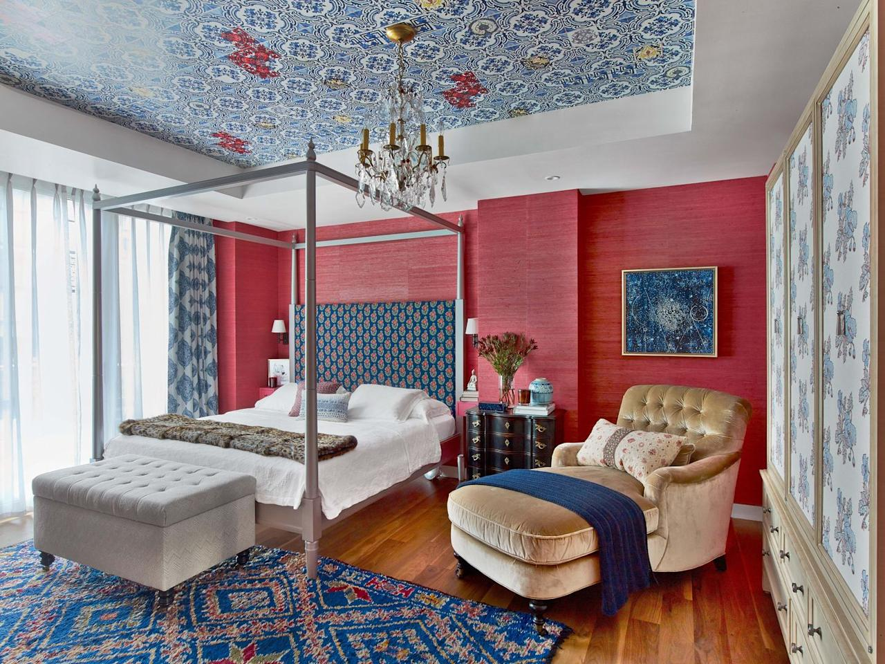 """<p>Colorful patterns and a vibrant grasscloth bring a sense of joy to this bedroom designed by <a href=""""https://www.chairish.com/shop/kati-curtis-design"""" target=""""_blank"""">Kati Curtis Design</a>.</p>"""