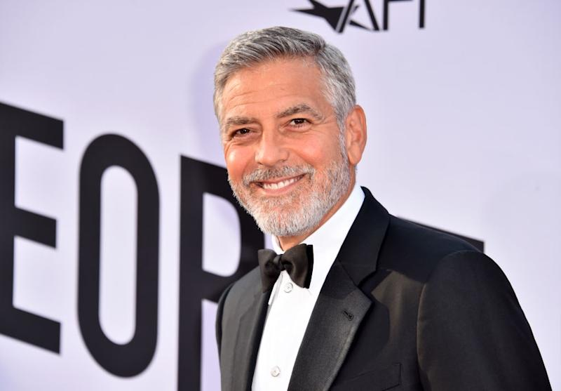 George Clooney has helped to inspire Brits to embrace their natural locks [Photo: Getty]