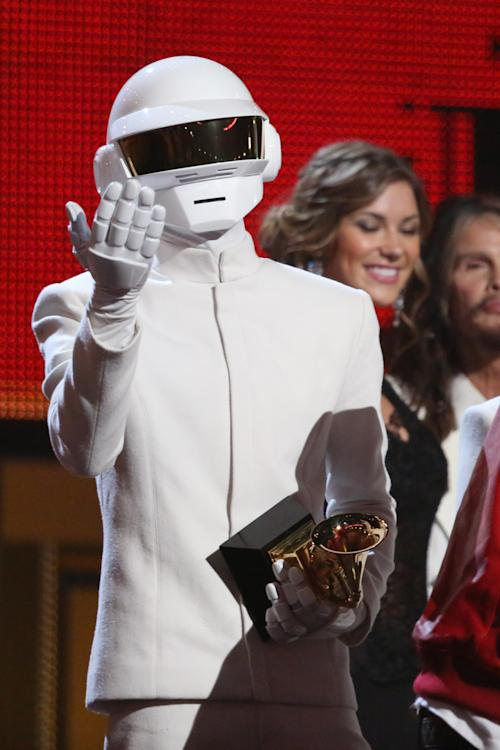 "Thomas Bangalter, of Daft Punk, accepts the award for record of the year for ""Get Lucky"" at the 56th annual Grammy Awards at Staples Center on Sunday, Jan. 26, 2014, in Los Angeles. (Photo by Matt Sayles/Invision/AP)"