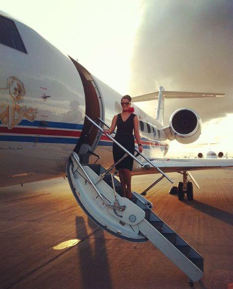 Kimberly climbs aboard one of the private jets she helps service for the world's most elite passengers